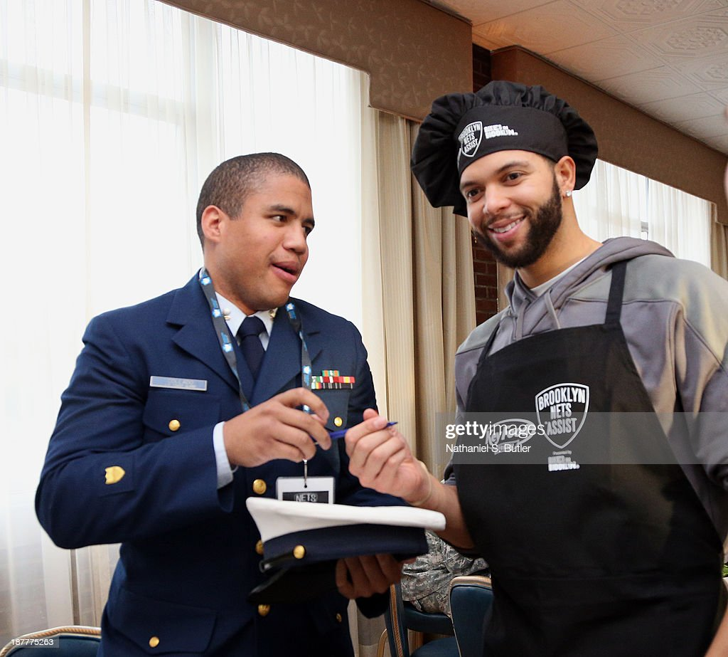 Deron Williams #8 of the Brooklyn Nets serves food during a team event in celebration of Veterans Day at Ft. Hamilton, Brooklyn on November 11, 2013 in the Brooklyn borough of New York City.