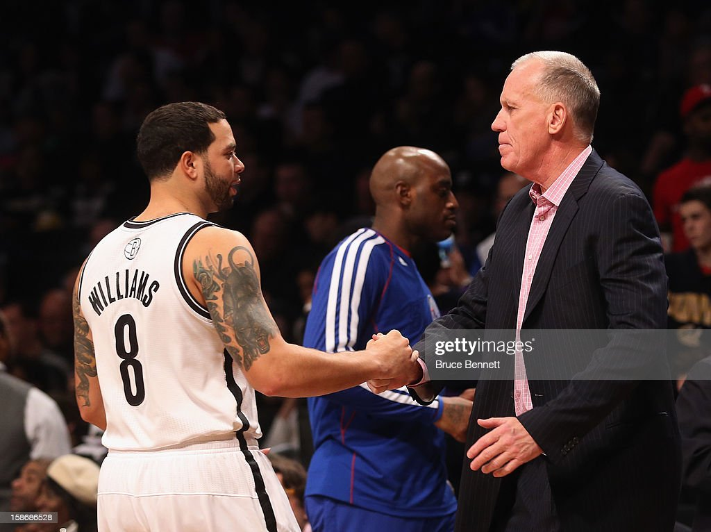 <a gi-track='captionPersonalityLinkClicked' href=/galleries/search?phrase=Deron+Williams&family=editorial&specificpeople=203215 ng-click='$event.stopPropagation()'>Deron Williams</a> #8 of the Brooklyn Nets shakes hands with Philadelphia 76ers head coach <a gi-track='captionPersonalityLinkClicked' href=/galleries/search?phrase=Doug+Collins&family=editorial&specificpeople=238972 ng-click='$event.stopPropagation()'>Doug Collins</a> following the game at the Barclays Center on December 23, 2012 in the Brooklyn borough of New York City.