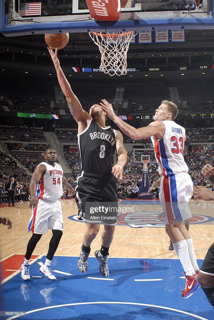 Deron Williams #8 of the Brooklyn Nets shoots a layup against Jonas Jerebko #33 of the Detroit Pistons on March 18, 2013 at The Palace of Auburn Hills in Auburn Hills, Michigan.