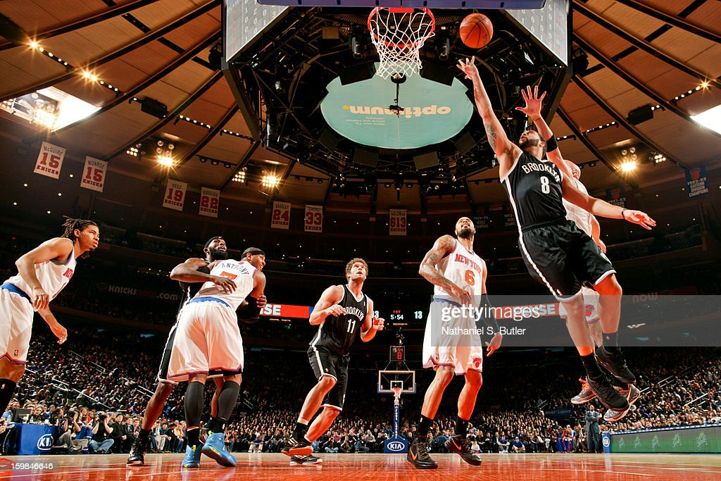Deron Williams #8 of the Brooklyn Nets shoots a layup against the New York Knicks on January 21, 2013 at Madison Square Garden in New York City.