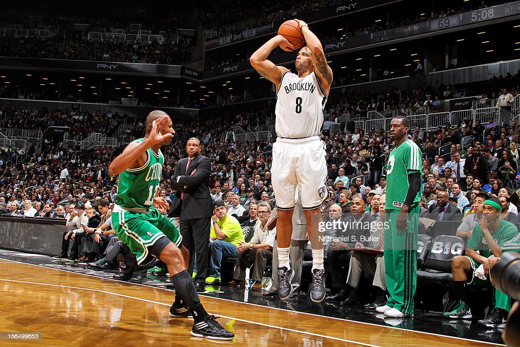 Deron Williams #8 of the Brooklyn Nets shoots a three-pointer against Leandro Barbosa #12 of the Boston Celtics on November 15, 2012 at the Barclays Center in the Brooklyn borough of New York City.