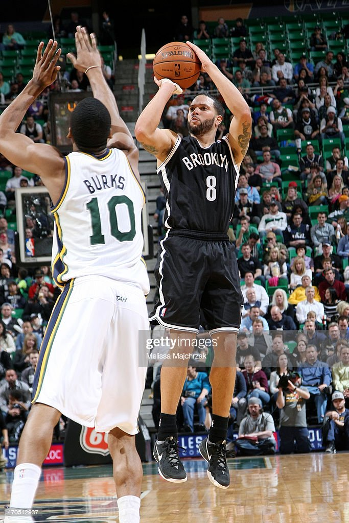 <a gi-track='captionPersonalityLinkClicked' href=/galleries/search?phrase=Deron+Williams&family=editorial&specificpeople=203215 ng-click='$event.stopPropagation()'>Deron Williams</a> #8 of the Brooklyn Nets shoots against Alec Burks #10 of the Utah Jazz at EnergySolutions Arena on February 19, 2014 in Salt Lake City, Utah.