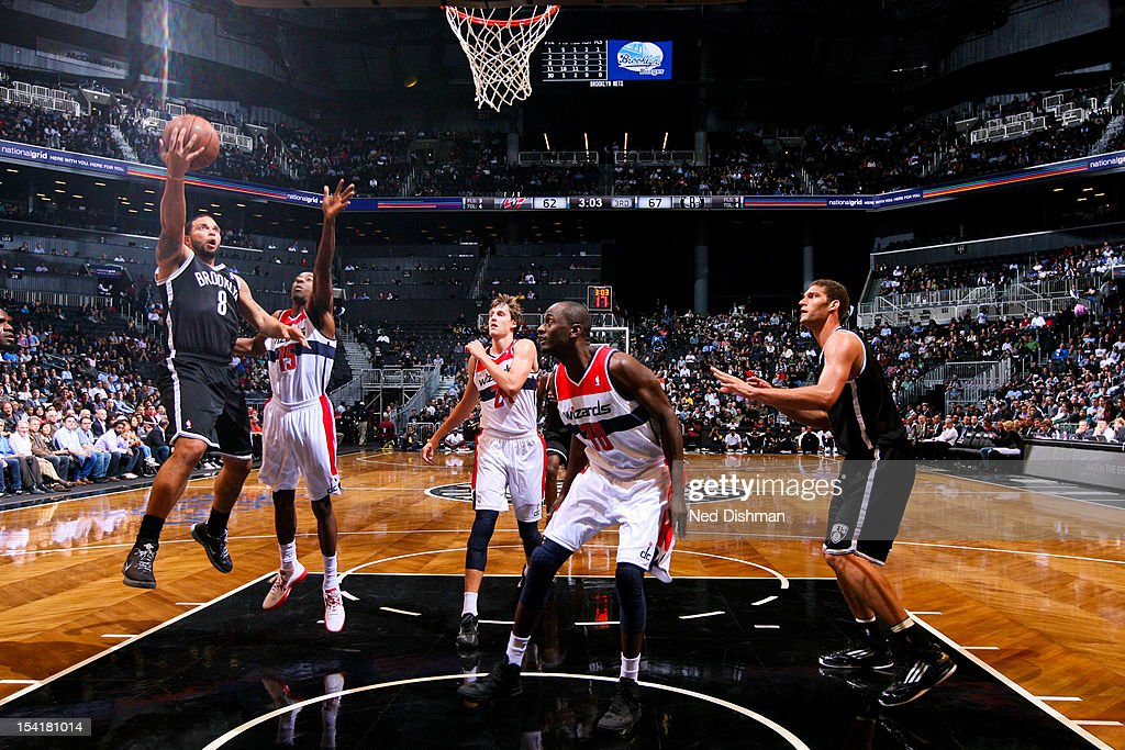 <a gi-track='captionPersonalityLinkClicked' href=/galleries/search?phrase=Deron+Williams&family=editorial&specificpeople=203215 ng-click='$event.stopPropagation()'>Deron Williams</a> #8 of the Brooklyn Nets shoots against <a gi-track='captionPersonalityLinkClicked' href=/galleries/search?phrase=Jordan+Crawford&family=editorial&specificpeople=4779380 ng-click='$event.stopPropagation()'>Jordan Crawford</a> #15 of the Washington Wizards at the Barclays Center on October 15, 2012 in the Brooklyn borough of New York City.