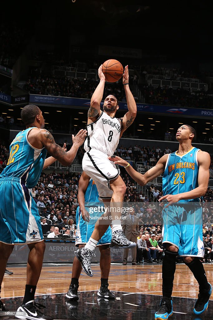 <a gi-track='captionPersonalityLinkClicked' href=/galleries/search?phrase=Deron+Williams&family=editorial&specificpeople=203215 ng-click='$event.stopPropagation()'>Deron Williams</a> #8 of the Brooklyn Nets shoots against <a gi-track='captionPersonalityLinkClicked' href=/galleries/search?phrase=Lance+Thomas&family=editorial&specificpeople=3847256 ng-click='$event.stopPropagation()'>Lance Thomas</a> #42 and Anthony Davis #23 of the New Orleans Hornets on March 12, 2013 at the Barclays Center in the Brooklyn borough of New York City.
