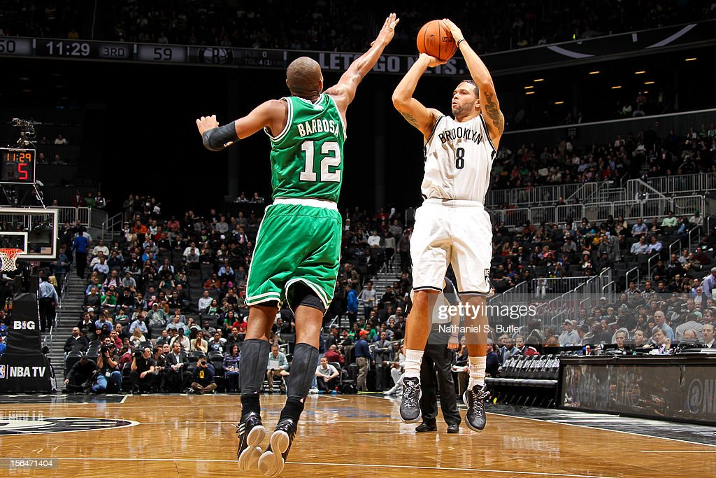 Deron Williams #8 of the Brooklyn Nets shoots against Leandro Barbosa #12 of the Boston Celtics on November 15, 2012 at the Barclays Center in the Brooklyn Borough of New York City.