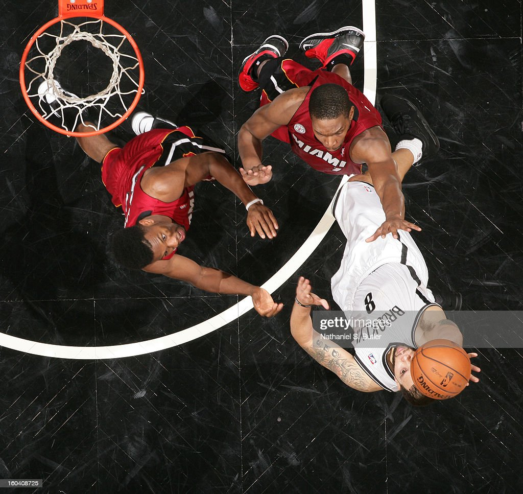 <a gi-track='captionPersonalityLinkClicked' href=/galleries/search?phrase=Deron+Williams&family=editorial&specificpeople=203215 ng-click='$event.stopPropagation()'>Deron Williams</a> #8 of the Brooklyn Nets shoots against <a gi-track='captionPersonalityLinkClicked' href=/galleries/search?phrase=Norris+Cole&family=editorial&specificpeople=5770147 ng-click='$event.stopPropagation()'>Norris Cole</a> #30 of the Miami Heat and <a gi-track='captionPersonalityLinkClicked' href=/galleries/search?phrase=Chris+Bosh&family=editorial&specificpeople=201574 ng-click='$event.stopPropagation()'>Chris Bosh</a> #1 of the Miami Heat on January 30, 2013 at the Barclays Center in the Brooklyn borough of New York City.