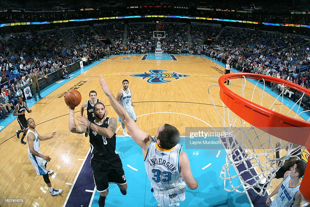 <a gi-track='captionPersonalityLinkClicked' href=/galleries/search?phrase=Deron+Williams&family=editorial&specificpeople=203215 ng-click='$event.stopPropagation()'>Deron Williams</a> #8 of the Brooklyn Nets shoots against Ryan Anderson #33 of the New Orleans Hornets on February 26, 2013 at the New Orleans Arena in New Orleans, Louisiana.