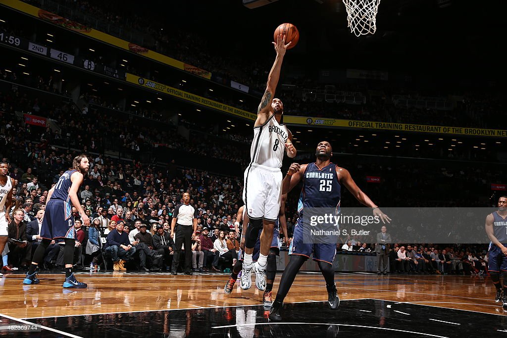 <a gi-track='captionPersonalityLinkClicked' href=/galleries/search?phrase=Deron+Williams&family=editorial&specificpeople=203215 ng-click='$event.stopPropagation()'>Deron Williams</a> #8 of the Brooklyn Nets shoots against the Charlotte Bobcats at the Barclays Center on February 12, 2014 in the Brooklyn borough of New York City.