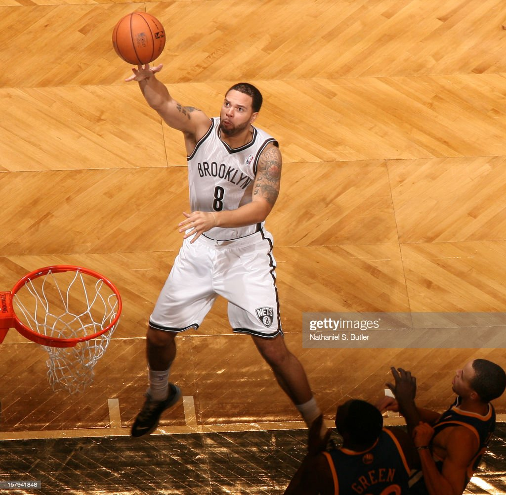 <a gi-track='captionPersonalityLinkClicked' href=/galleries/search?phrase=Deron+Williams&family=editorial&specificpeople=203215 ng-click='$event.stopPropagation()'>Deron Williams</a> #8 of the Brooklyn Nets shoots against the Golden State Warriors on December 7, 2012 at the Barclays Center in the Brooklyn Borough of New York City.