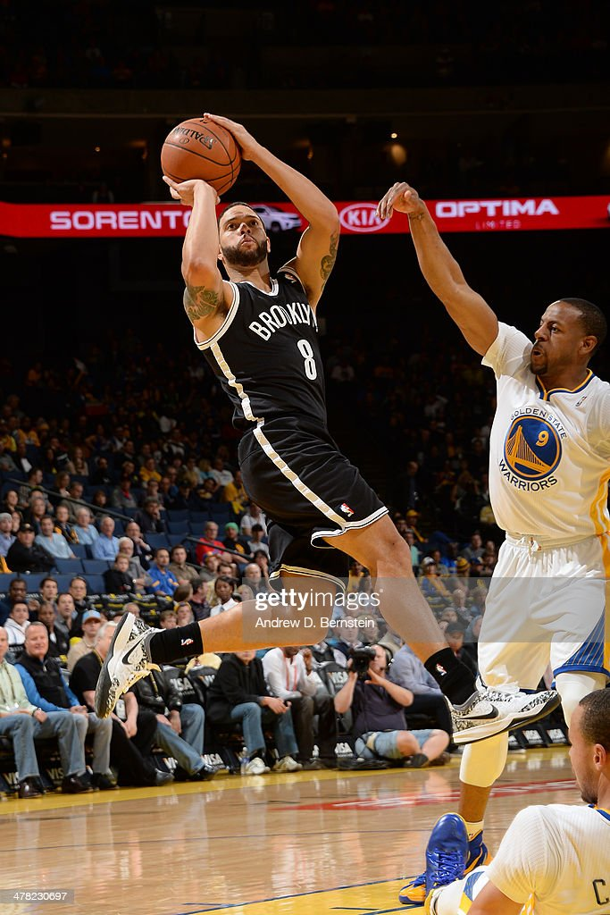 <a gi-track='captionPersonalityLinkClicked' href=/galleries/search?phrase=Deron+Williams&family=editorial&specificpeople=203215 ng-click='$event.stopPropagation()'>Deron Williams</a> #8 of the Brooklyn Nets shoots against the Golden State Warriors at Oracle Arena on February 22, 2014 in Oakland, California.
