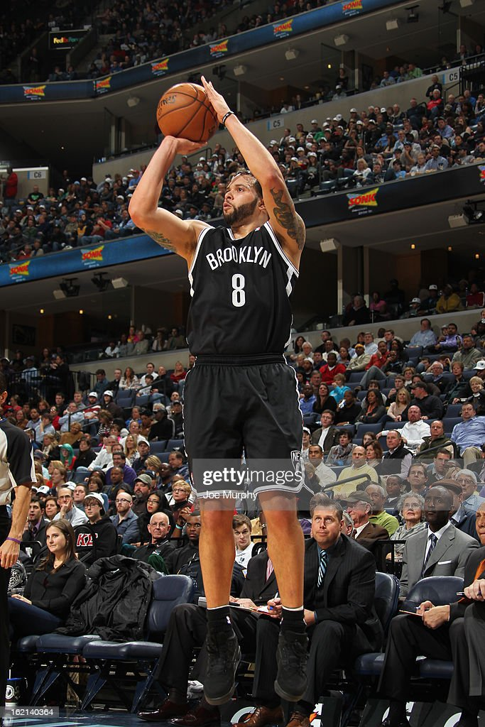 <a gi-track='captionPersonalityLinkClicked' href=/galleries/search?phrase=Deron+Williams&family=editorial&specificpeople=203215 ng-click='$event.stopPropagation()'>Deron Williams</a> #8 of the Brooklyn Nets shoots against the Memphis Grizzlies on January 25, 2013 at FedExForum in Memphis, Tennessee.
