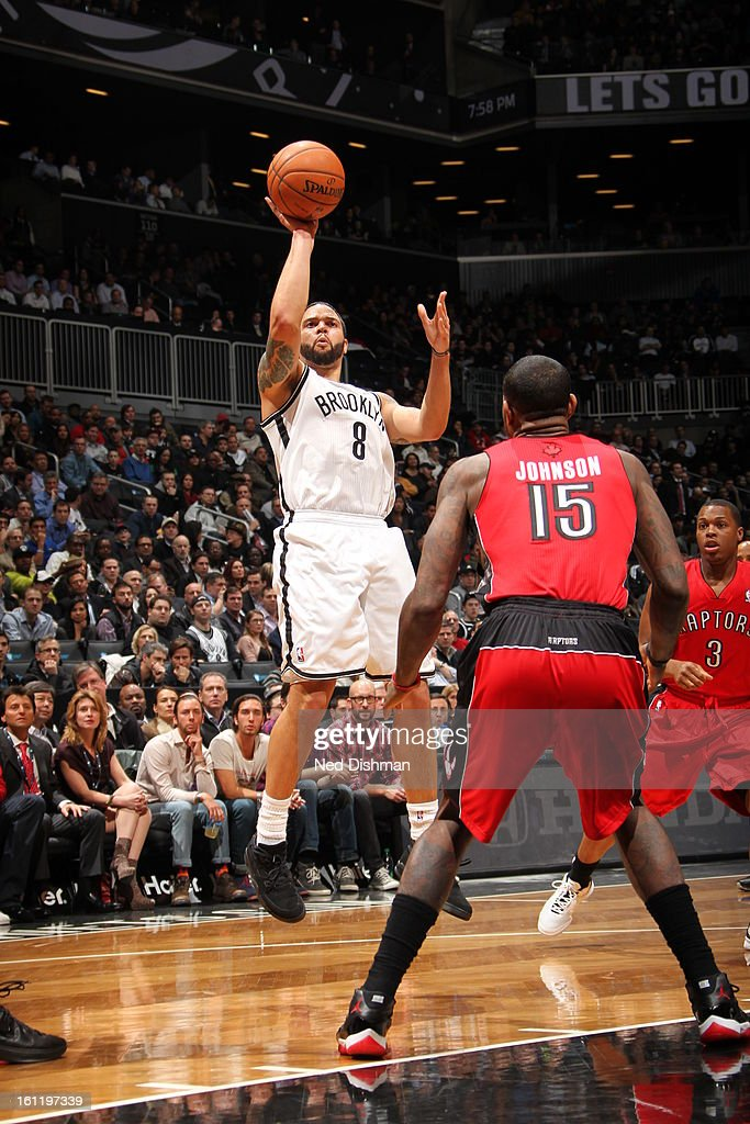 <a gi-track='captionPersonalityLinkClicked' href=/galleries/search?phrase=Deron+Williams&family=editorial&specificpeople=203215 ng-click='$event.stopPropagation()'>Deron Williams</a> #8 of the Brooklyn Nets shoots against the Toronto Raptors at the Barclays Center on January 15, 2013 in the Brooklyn borough of New York City in New York City.