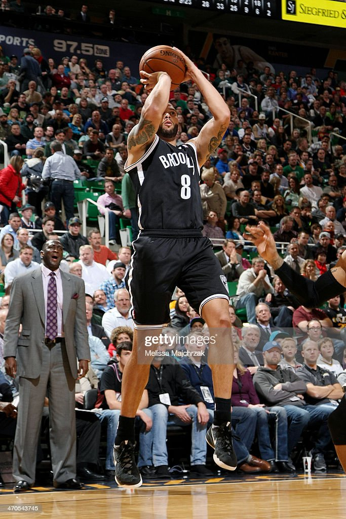 <a gi-track='captionPersonalityLinkClicked' href=/galleries/search?phrase=Deron+Williams&family=editorial&specificpeople=203215 ng-click='$event.stopPropagation()'>Deron Williams</a> #8 of the Brooklyn Nets shoots against the Utah Jazz at EnergySolutions Arena on February 19, 2014 in Salt Lake City, Utah.