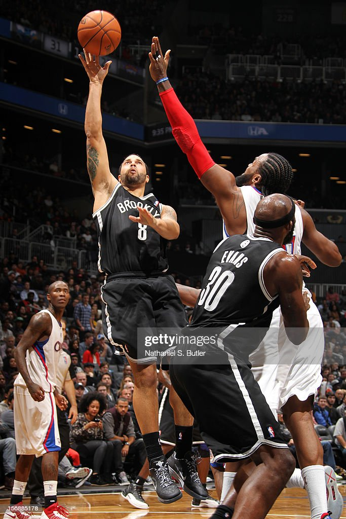 <a gi-track='captionPersonalityLinkClicked' href=/galleries/search?phrase=Deron+Williams&family=editorial&specificpeople=203215 ng-click='$event.stopPropagation()'>Deron Williams</a> #8 of the Brooklyn Nets shoots over <a gi-track='captionPersonalityLinkClicked' href=/galleries/search?phrase=Ronny+Turiaf&family=editorial&specificpeople=224998 ng-click='$event.stopPropagation()'>Ronny Turiaf</a> #21 of the Los Angeles Clippers on November 23, 2012 at the Barclays Center in the Brooklyn Borough of New York City.