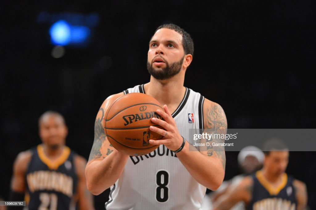 <a gi-track='captionPersonalityLinkClicked' href=/galleries/search?phrase=Deron+Williams&family=editorial&specificpeople=203215 ng-click='$event.stopPropagation()'>Deron Williams</a> #8 of the Brooklyn Nets shoots the ball against Indiana Pacers during the game at the Barclays Center on January 13, 2013 in Brooklyn, New York.