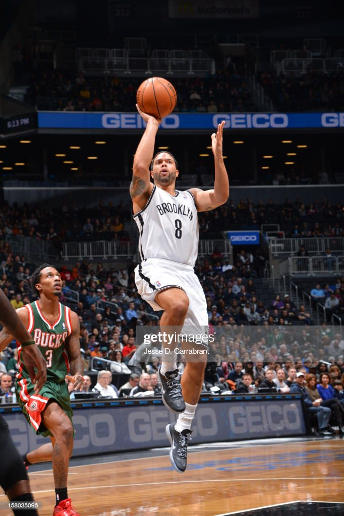 Deron Williams #8 of the Brooklyn Nets shoots the ball against the Milwaukee Bucks at the Barclays Center on December 9, 2012 in Brooklyn, New York.