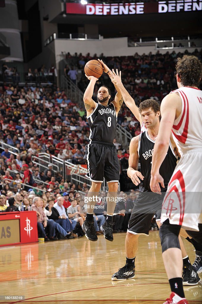 Deron Williams #8 of the Brooklyn Nets shoots the ball against the Houston Rockets on January 26, 2013 at the Toyota Center in Houston, Texas.