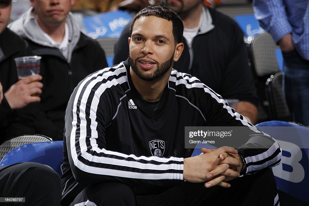 Deron Williams #8 of the Brooklyn Nets sits on the bench before the game against the Dallas Mavericks on March 20, 2013 at the American Airlines Center in Dallas, Texas.