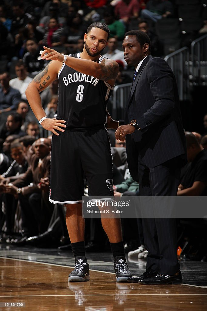 <a gi-track='captionPersonalityLinkClicked' href=/galleries/search?phrase=Deron+Williams&family=editorial&specificpeople=203215 ng-click='$event.stopPropagation()'>Deron Williams</a> #8 of the Brooklyn Nets speaks to head coach <a gi-track='captionPersonalityLinkClicked' href=/galleries/search?phrase=Avery+Johnson&family=editorial&specificpeople=201655 ng-click='$event.stopPropagation()'>Avery Johnson</a> while playing against the Boston Celtics during a pre-season game on October 18, 2012 at the Barclays Center in the Brooklyn borough of New York City.