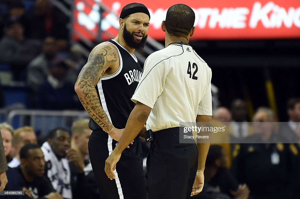 Deron Williams of the Brooklyn Nets speaks with referee Eric Lewis during a game against the New Orleans Pelicans at the Smoothie King Center on...