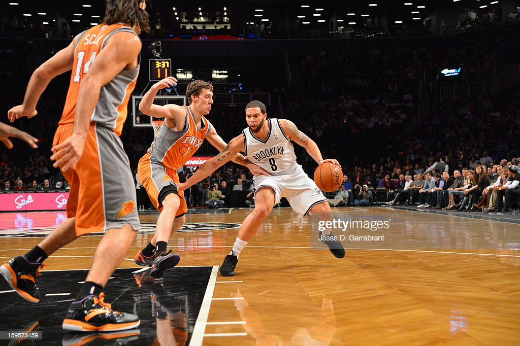 <a gi-track='captionPersonalityLinkClicked' href=/galleries/search?phrase=Deron+Williams&family=editorial&specificpeople=203215 ng-click='$event.stopPropagation()'>Deron Williams</a> #8 of the Brooklyn Nets steps back for a shot against the Phoenix Suns at the Barclays Center on January 11, 2013 in Brooklyn, New York.