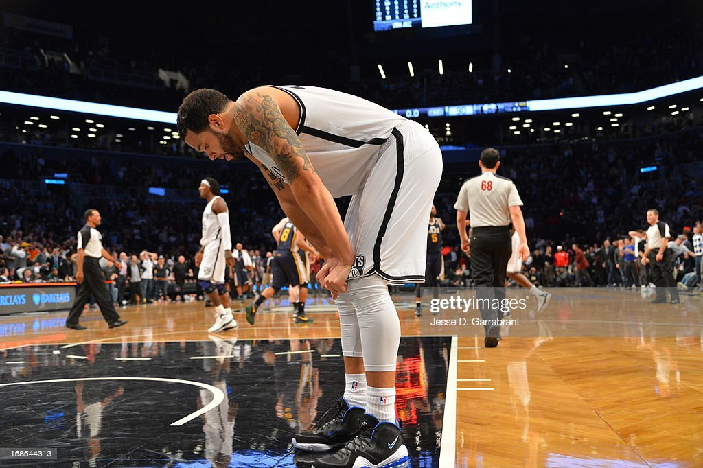 <a gi-track='captionPersonalityLinkClicked' href=/galleries/search?phrase=Deron+Williams&family=editorial&specificpeople=203215 ng-click='$event.stopPropagation()'>Deron Williams</a> #8 of the Brooklyn Nets takes a breather during the game against the Utah Jazz at the Barclays Center on December 18, 2012 in Brooklyn, New York.