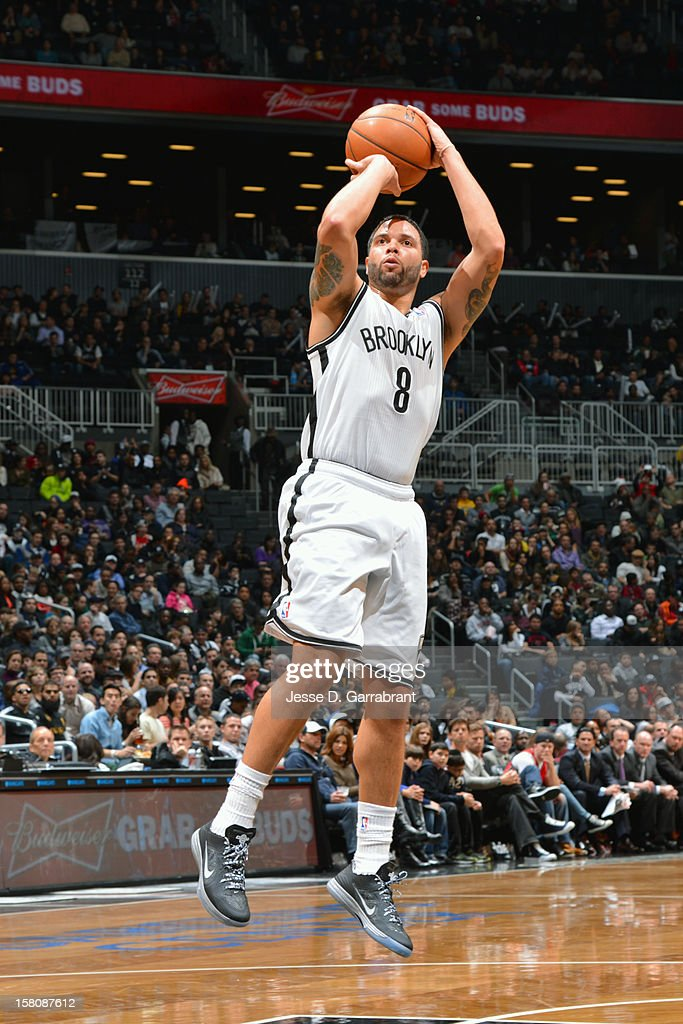 <a gi-track='captionPersonalityLinkClicked' href=/galleries/search?phrase=Deron+Williams&family=editorial&specificpeople=203215 ng-click='$event.stopPropagation()'>Deron Williams</a> #8 of the Brooklyn Nets takes a shot against the Milwaukee Bucks on December 9, 2012 at the Barclays Center in Brooklyn, New York.