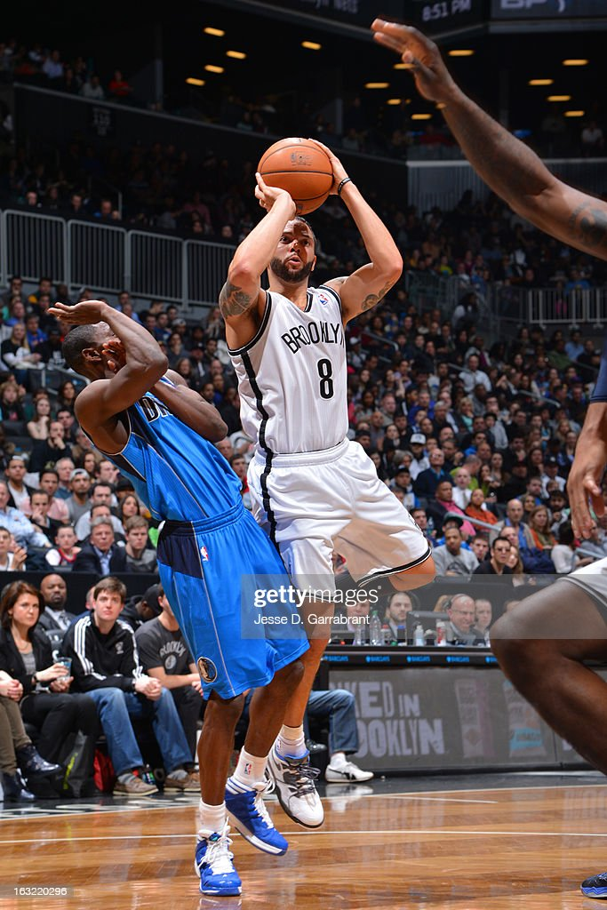 Deron Williams #8 of the Brooklyn Nets takes a shot against the Dallas Mavericks on March 1, 2013 at the Barclays Center in Brooklyn, New York.