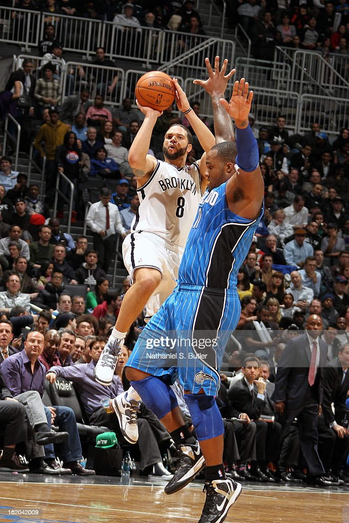 Deron Williams #8 of the Brooklyn Nets takes a shot against the Orlando Magic on January 28, 2013 at the Barclays Center in the Brooklyn borough of New York City.