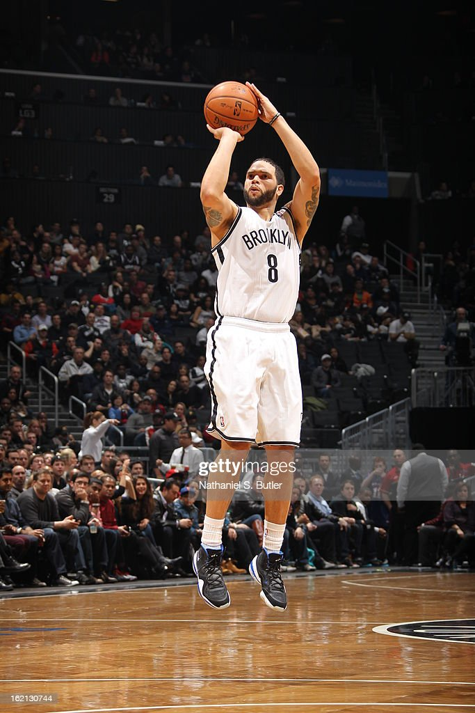 <a gi-track='captionPersonalityLinkClicked' href=/galleries/search?phrase=Deron+Williams&family=editorial&specificpeople=203215 ng-click='$event.stopPropagation()'>Deron Williams</a> #8 of the Brooklyn Nets takes a shot against the San Antonio Spurs on February 10, 2013 at the Barclays Center in the Brooklyn borough of New York City.