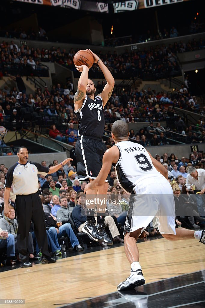 <a gi-track='captionPersonalityLinkClicked' href=/galleries/search?phrase=Deron+Williams&family=editorial&specificpeople=203215 ng-click='$event.stopPropagation()'>Deron Williams</a> #8 of the Brooklyn Nets takes a shot against Tony Parker #9 of the San Antonio Spurs on December 31, 2012 at the AT&T Center in San Antonio, Texas.