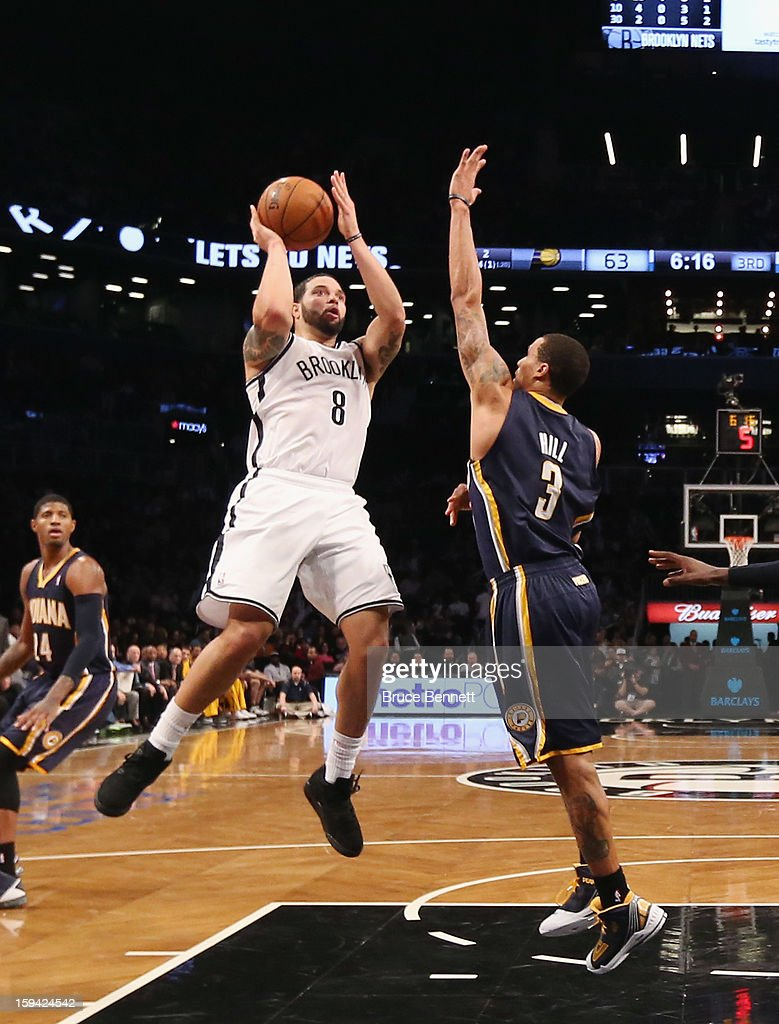 Deron Williams #8 of the Brooklyn Nets takes the shot in the fourth quarter against the Indiana Pacers at the Barclays Center on January 13, 2013 in New York City.