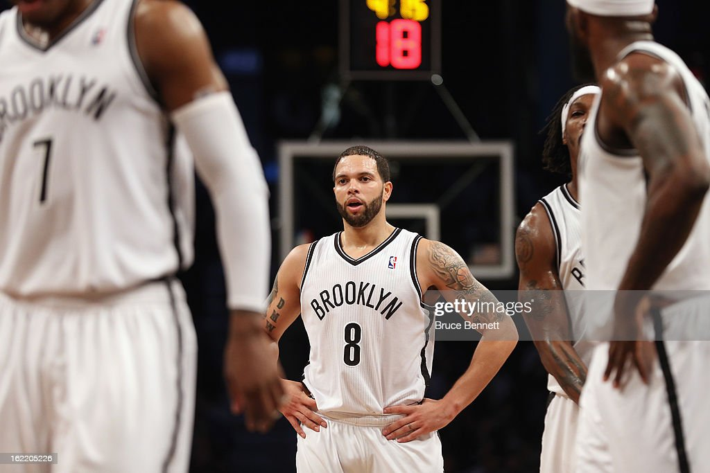 <a gi-track='captionPersonalityLinkClicked' href=/galleries/search?phrase=Deron+Williams&family=editorial&specificpeople=203215 ng-click='$event.stopPropagation()'>Deron Williams</a> #8 of the Brooklyn Nets waits for play to begin against the Milwaukee Bucks at the Barclays Center on February 19, 2013 in New York City.