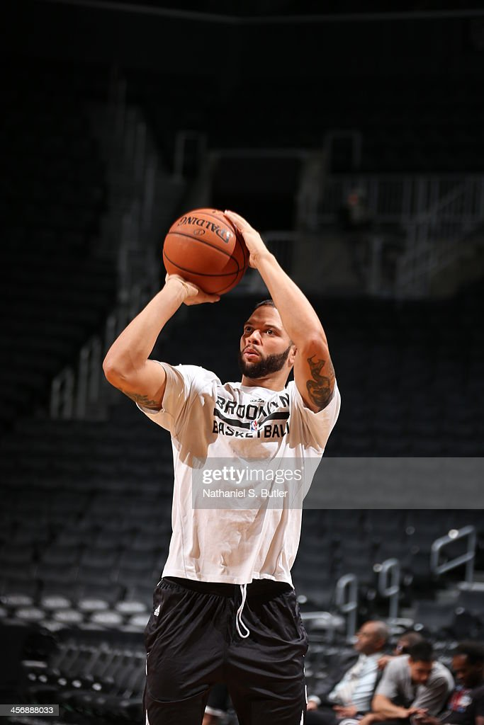 <a gi-track='captionPersonalityLinkClicked' href=/galleries/search?phrase=Deron+Williams&family=editorial&specificpeople=203215 ng-click='$event.stopPropagation()'>Deron Williams</a> #8 of the Brooklyn Nets warms-up against the Indiana Pacers during a game at Barclays Center on November 9, 2013 in the Brooklyn borough of New York City.