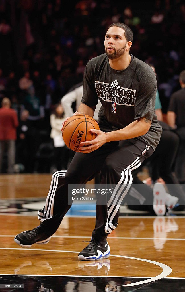 Deron Williams #8 of the Brooklyn Nets wears Nike sneakers during warm ups prior to the game against the Boston Celtics at the Barclays Center on December 25, 2012 in the Brooklyn borough of New York City.