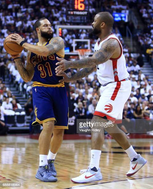 Deron Williams of the Cleveland Cavaliers dribbles the ball as PJ Tucker of the Toronto Raptors defends in the first half of Game Four of the Eastern...