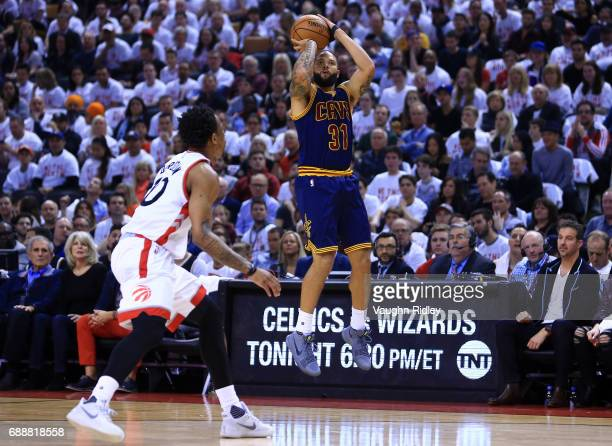 Deron Williams of the Cleveland Cavaliers shoots the ball as DeMar DeRozan of the Toronto Raptors defends in the first half of Game Four of the...