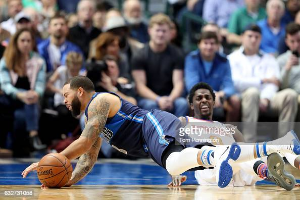 Deron Williams of the Dallas Mavericks collides with Justin Holiday of the New York Knicks in the first half at American Airlines Center on January...