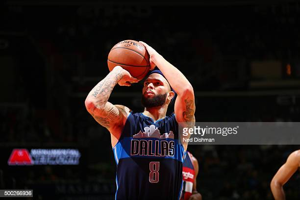 Deron Williams of the Dallas Mavericks shoots a free throw against the Washington Wizards on December 6 2015 at Verizon Center in Washington DC NOTE...