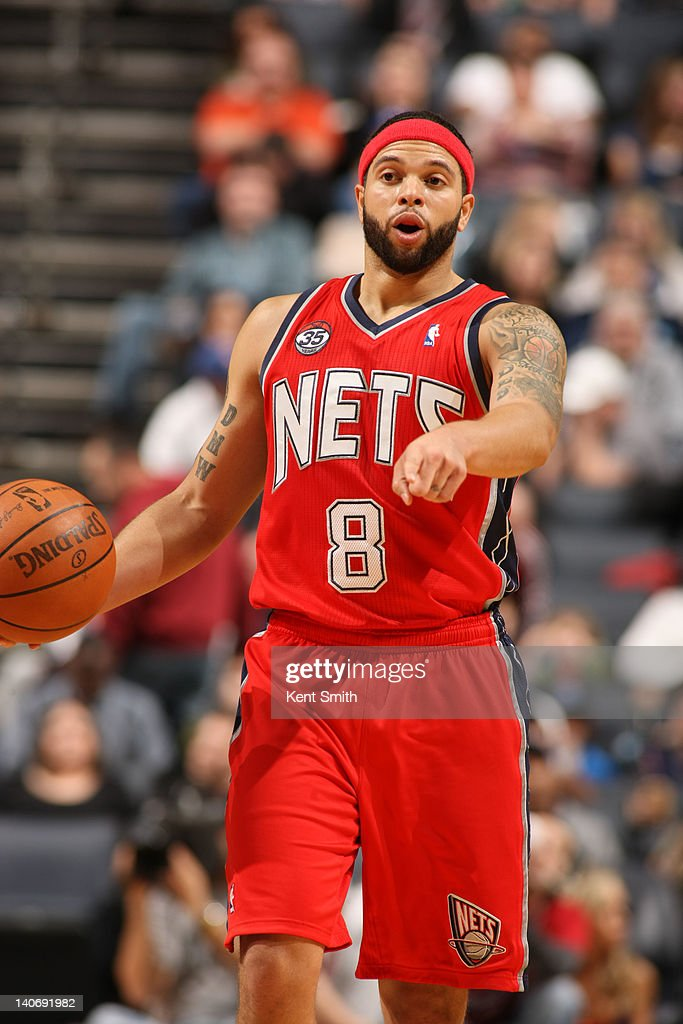 Deron Williams #8 of the New Jersey Nets calls a play against the Charlotte Bobcats on March 4, 2012 at the Time Warner Cable Arena in Charlotte, North Carolina.
