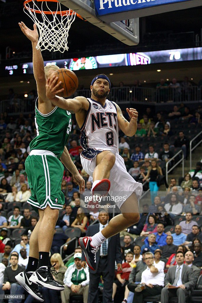 Deron Williams of the New Jersey Nets drives for a shot attempt in the second half against Greg Stiemsma of the Boston Celtics at Prudential Center...