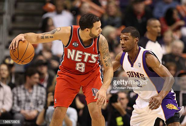 Deron Williams of the New Jersey Nets handles the ball against Ronnie Price of the Phoenix Suns during the NBA game at US Airways Center on January...