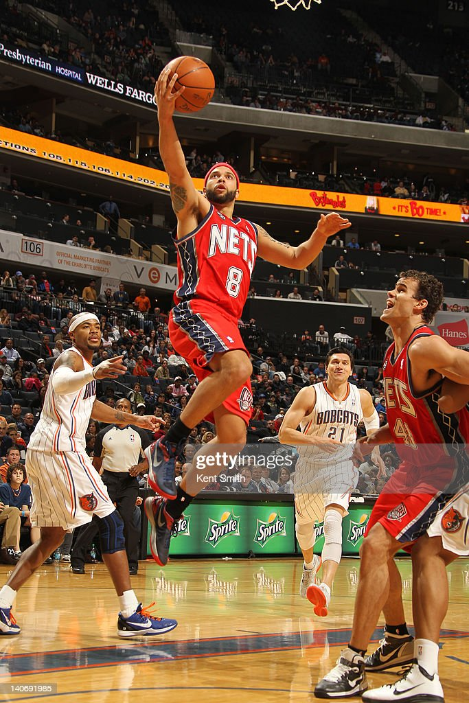 <a gi-track='captionPersonalityLinkClicked' href=/galleries/search?phrase=Deron+Williams&family=editorial&specificpeople=203215 ng-click='$event.stopPropagation()'>Deron Williams</a> #8 of the New Jersey Nets shoots a layup against the Charlotte Bobcats during the game at the Time Warner Cable Arena on March 4, 2012 in Charlotte, North Carolina.