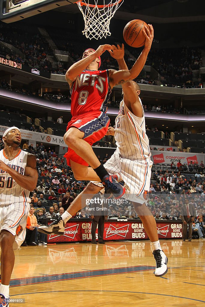 <a gi-track='captionPersonalityLinkClicked' href=/galleries/search?phrase=Deron+Williams&family=editorial&specificpeople=203215 ng-click='$event.stopPropagation()'>Deron Williams</a> #8 of the New Jersey Nets shoots against <a gi-track='captionPersonalityLinkClicked' href=/galleries/search?phrase=Boris+Diaw&family=editorial&specificpeople=201505 ng-click='$event.stopPropagation()'>Boris Diaw</a> #32 of the Charlotte Bobcats during the game at the Time Warner Cable Arena on March 4, 2012 in Charlotte, North Carolina.