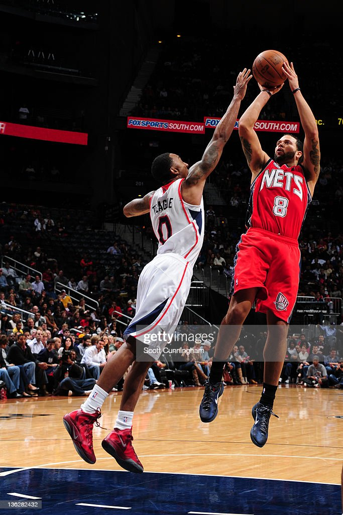 Deron Williams #8 of the New Jersey Nets shoots against Jeff Teague #0 of the Atlanta Hawks on December 30, 2011 at Philips Arena in Atlanta, Georgia.