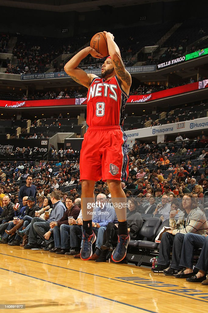 <a gi-track='captionPersonalityLinkClicked' href=/galleries/search?phrase=Deron+Williams&family=editorial&specificpeople=203215 ng-click='$event.stopPropagation()'>Deron Williams</a> #8 of the New Jersey Nets shoots against the Charlotte Bobcats during the game at the Time Warner Cable Arena on March 4, 2012 in Charlotte, North Carolina.