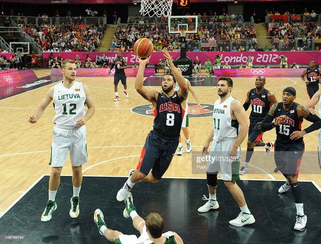 Deron Williams of the United States jumps with the ball past Antanas Kavaliauskas (L) and Linas Kleiza (2nd R) of Lithuania during the Men's Basketball Preliminary Round match between Lithuania and the United States on Day 8 of the London 2012 Olympic Games at Basketball Arena on August 4, 2012 in London, England.