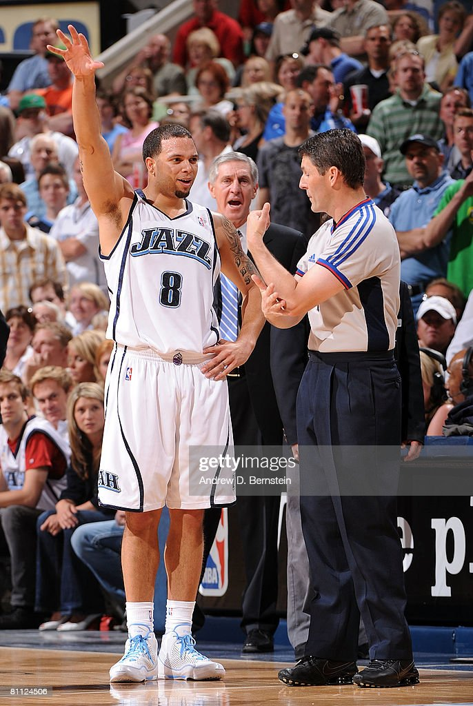 Deron Williams of the Utah Jazz argues a call at the end of the second quarter with referee Scott Foster while taking on the Los Angeles Lakers in...