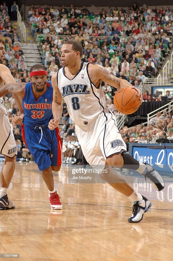 Deron Williams #8 of the Utah Jazz drives around Richard Hamilton #32 of the Detroit Pistons during the game on November 6, 2006 at the Delta Center in Salt Lake City, Utah. The Jazz won 103-101.
