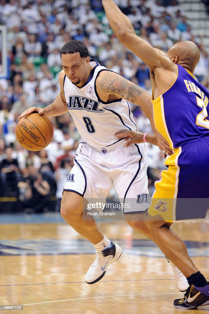 Deron Williams #8 of the Utah Jazz drives past Derek Fisher #2 of the Los Angeles Lakers in Game Three of the Western Conference Semifinals during the 2010 NBA Playoffs at the EnergySolutions Arena on May 8, 2010 in Salt Lake City, Utah.